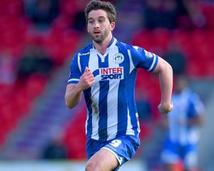Will Grigg fires FA Cup double for Wigan to sink Fylde hopes