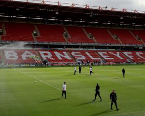 Barnsley taken over by consortium led by Chinese investor