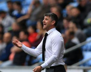 Motherwell manager Stephen Robinson looking up after sealing survival