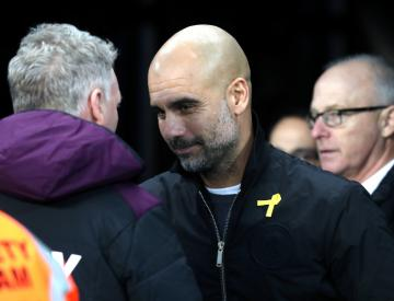 Man City boss Guardiola unfazed by possibility of suspension over yellow ribbon
