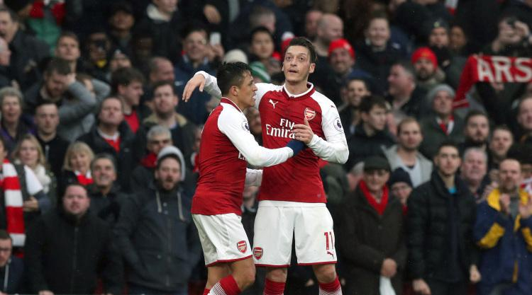 Arsene Wenger convinced Alexis Sanchez and Mesut Ozil love playing for Arsenal