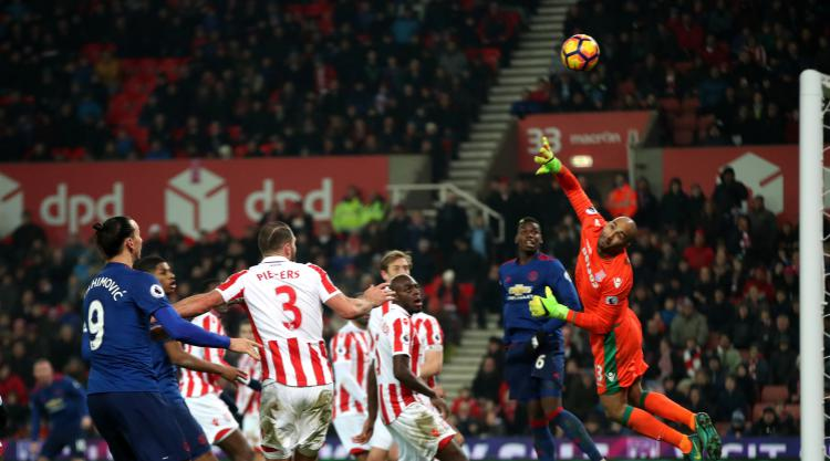 Record-breaking Rooney earns point for United
