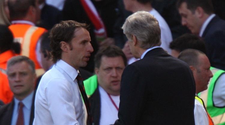 Arsenal boss Arsene Wenger keeps quiet on England job offer talk