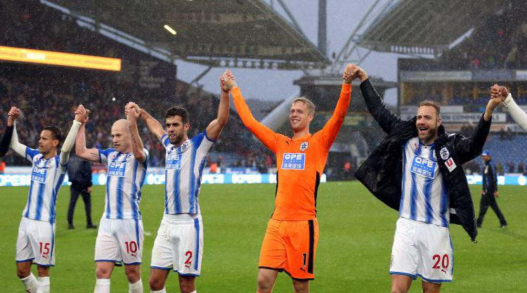 Huddersfield hold on to secure famous win over Manchester United
