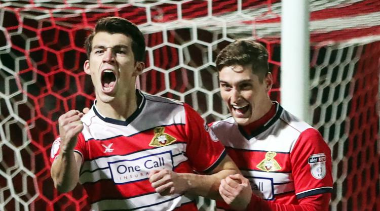 Doncaster down struggling Crewe to maintain four-point lead at top