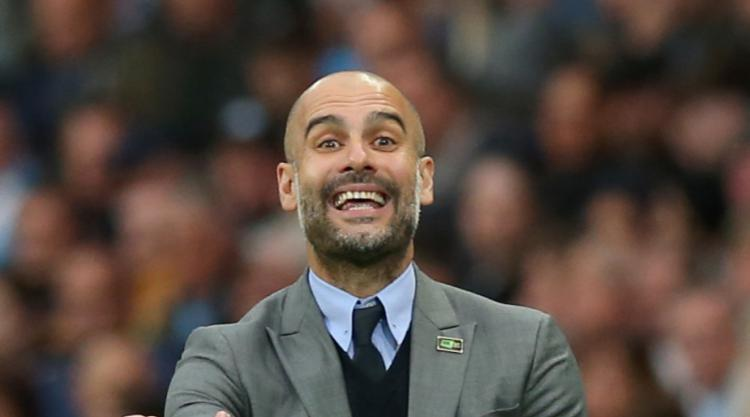 Manchester City boss Guardiola wants one last push for Champions League spot